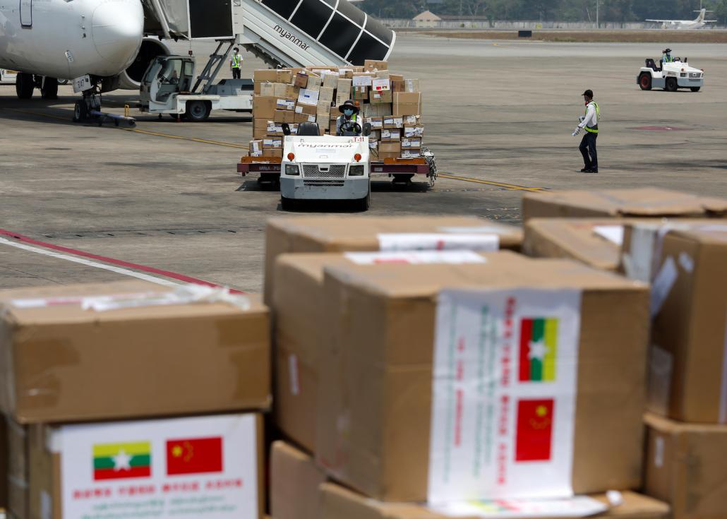 Yangon International Airport staff unload medical supplies brought by a Chinese medical team on April 8 to support Myanmar's COVID-19 response. (AFP)