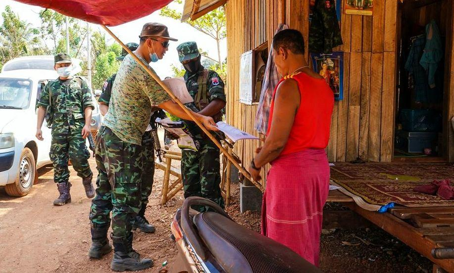 Members of the Karen National Liberation Army, the armed wing of the Karen National Union, hand out information about COVID-19 as part of the group's prevention measures. (Supplied)