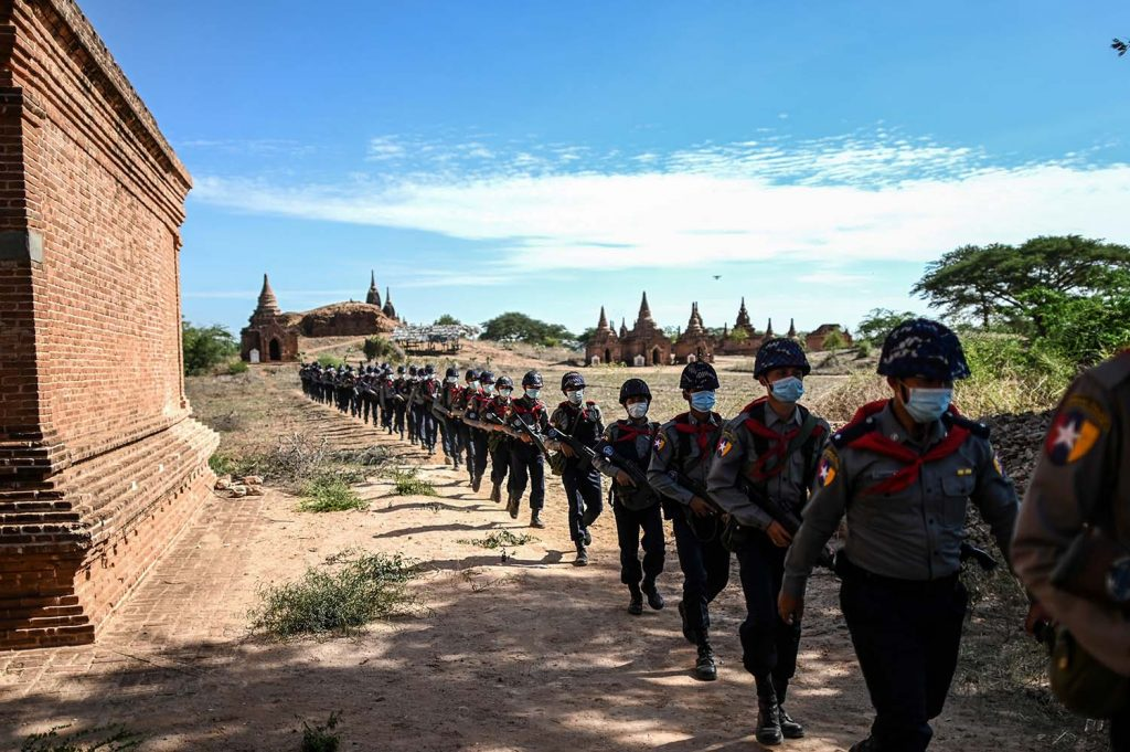 Members of a police squad patrol pagodas in a temple complex in Bagan, Mandalay Region, on June 23. (AFP)