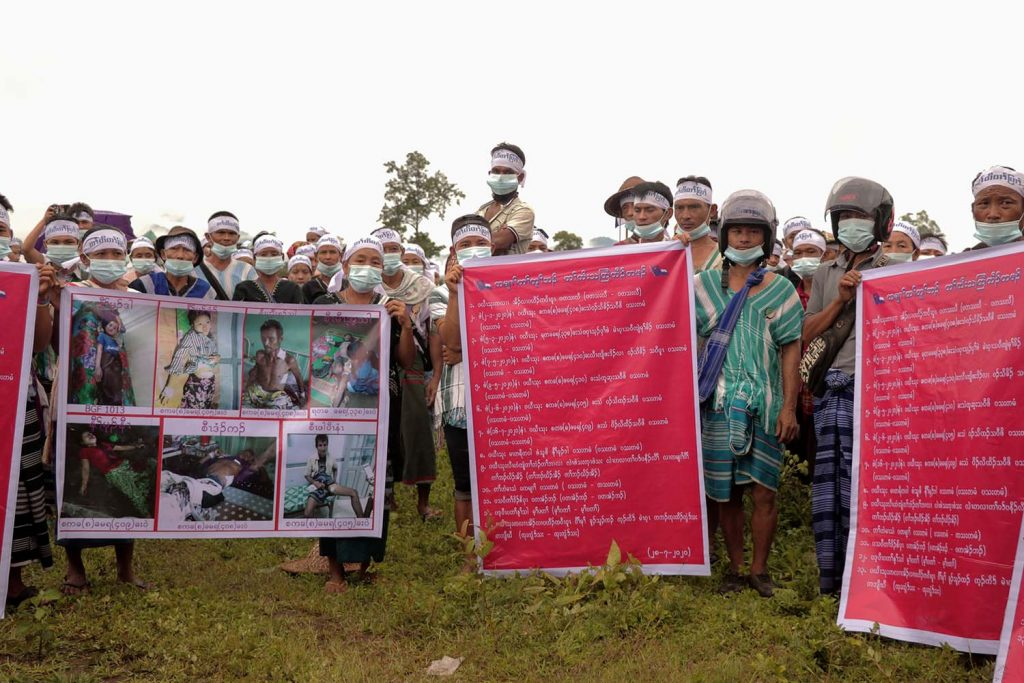Karen people hold posters and shout slogans during a protest against the Tatmadaw at Papun in Kayin State on July 28 (AFP)