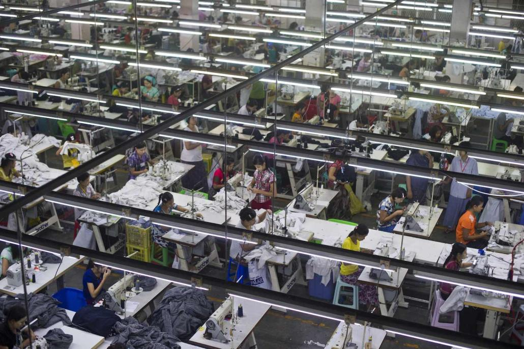 Employees at a garment factory in the Shwe Pyi Thar industrial zone in September 2015. Workers in Yangon's garment sector are thought to send back hundreds of millions of dollars a year to rural communities. (Ye Aung Thu | AFP)
