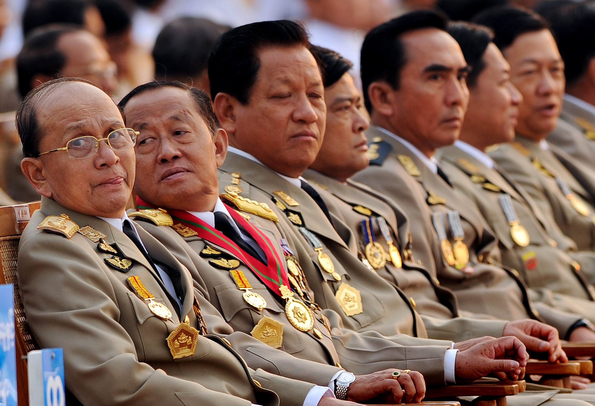 Thein Sein, left, along with senior leaders attends a military parade marking the country's 65th Armed Forces Day at a parade ground in Nay Pyi Taw on March 27, 2010. (Christophe Archambault / AFP)