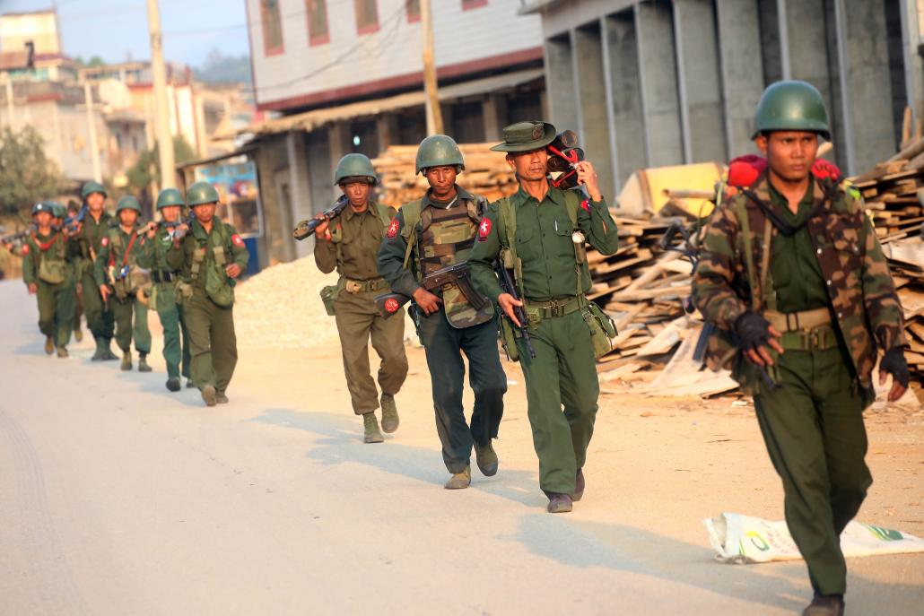 Tatmadaw soldiers patrol in Laukkai, the main city in the Kokang region, on February 16, 2015. (AFP)
