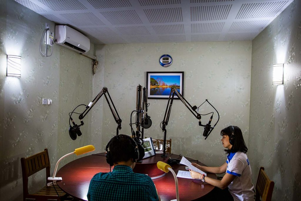 Broadcasting gets underway at the City FM studio in Yangon on June 9. (Hkun Lat | Frontier)