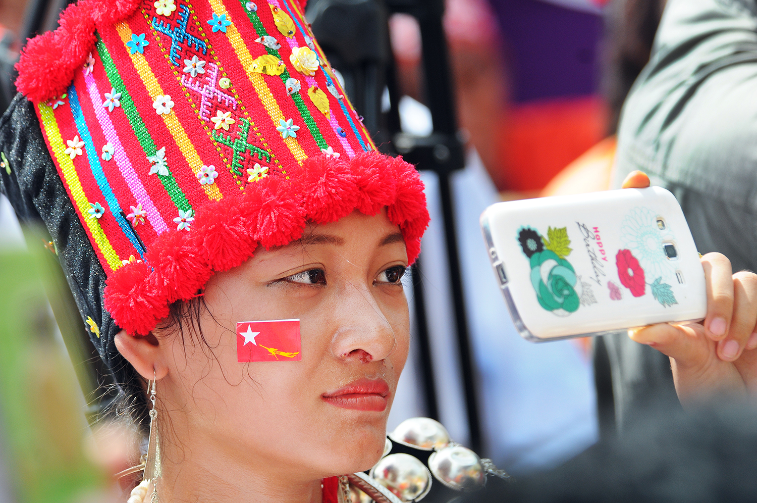 A Kachin woman attends a National League for Democracy rally in the Kachin State capital Myitkyina on October 2, 2015 ahead of the general election that year. (Steve Tickner | Frontier)