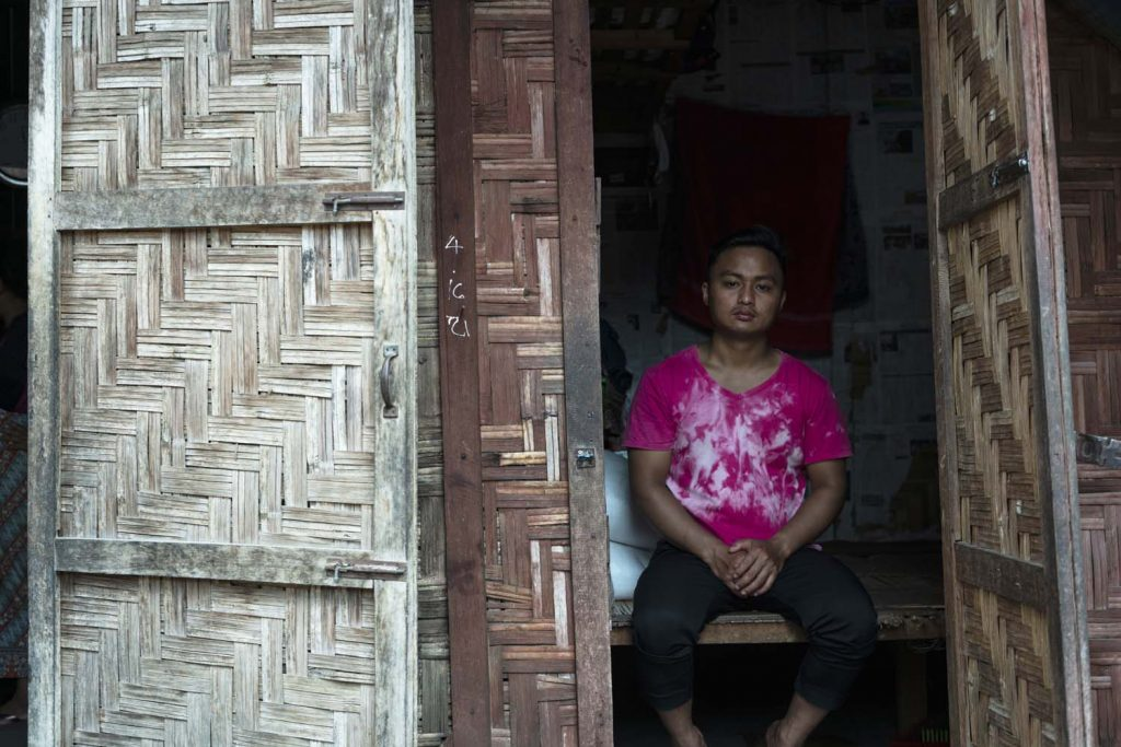 Zau Lawt, who fled his village of San Pai aged 14 in 2011, supports his family as a day labourer on farms and building sites in China, returning to the Sha-it Yang IDP camp at night. (Hkun Ring | Frontier)