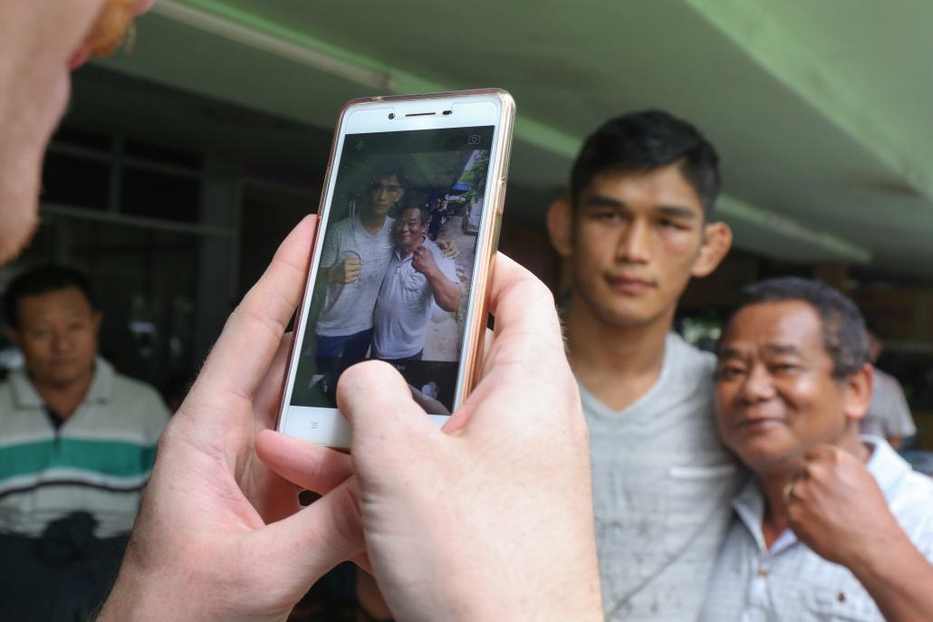 "/></p><p>Returning to his childhood home, Aung La Nsang said it felt like he had been away a lifetime. He ate snacks that he missed from his youth and visited grandparents, even reconnecting with a street vendor who sold <em>moun sein baun</em> to him as a kid.</p><p>""She knew exactly who I was,"" he said. ""She knew I was the kid that she used to sell snacks to.""</p><p>No longer a child, he's now many other things: a father who takes his young son to a Kachin Baptist Church in Maryland once a week for Sunday school with other Kachin language speakers; a cage fighter who will go up to 25 minutes in the ring with a man intent on destroying him; a bona fide celebrity in the country he left behind, graciously posing for selfies with grinning immigration officers at the Yangon Airport.</p><p>Did the snack seller in Myitkyina recognise him as the Burmese Python – the Myanmar superstar?</p><p>""I'm not so sure about that,"" he said, tilting his head. ""But she recognised me for who I am."" </p><p><strong><em>Additional reporting by Sam Aung Moon</em></strong></p></body>"
