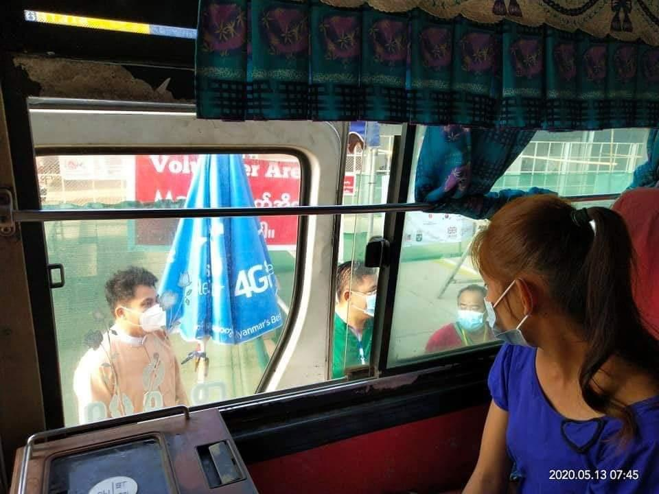 A returning migrant worker looks out from a bus at Myawaddy bound for Bago Region, where she will undergo 21 days' quarantine, on May 13. (Supplied)
