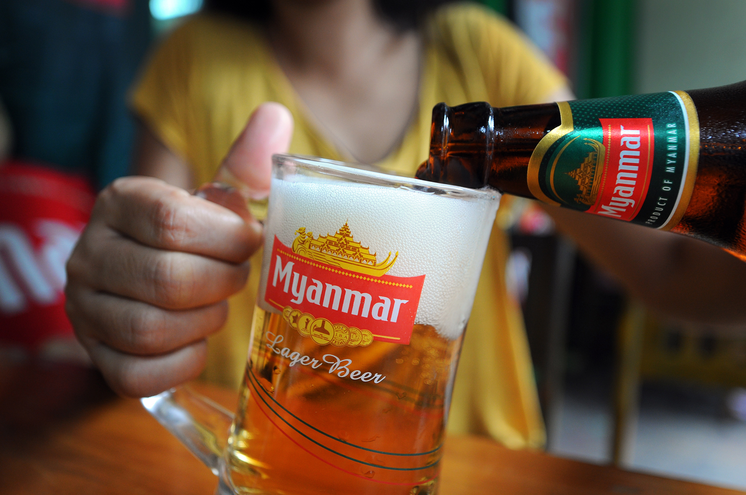 Ubiquitous in food shop coolers and on bar taps throughout the country, Myanmar Beer is produced by the military-owned Myanmar Brewery, in partnership with Japanese beer giant Kirin Holdings. (Steve Tickner | Frontier)