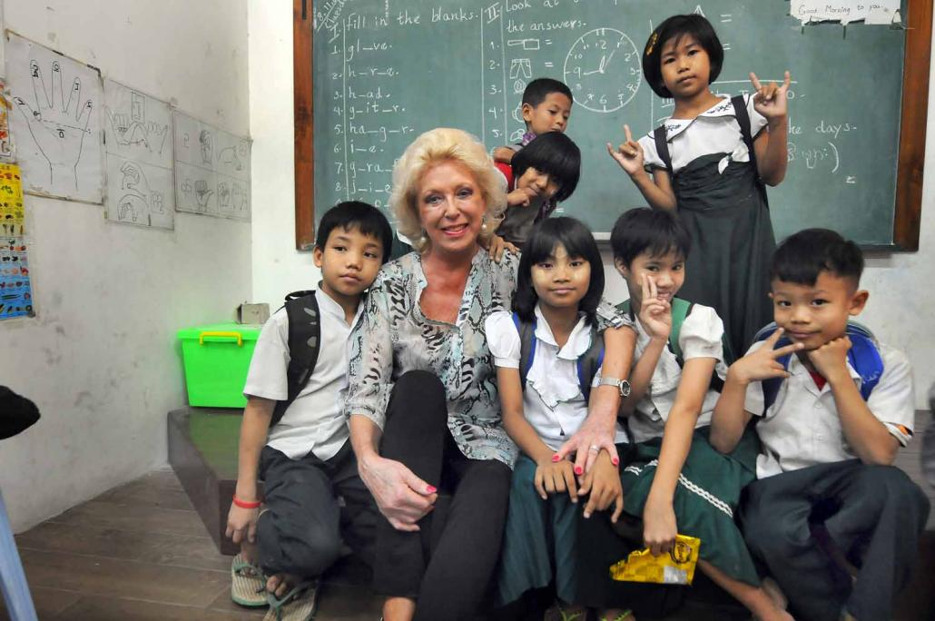 Ms Pamela McCourt Francescone with students at the Mary Chapman School for the Deaf in Yangon. (Steve Tickner / Frontier)