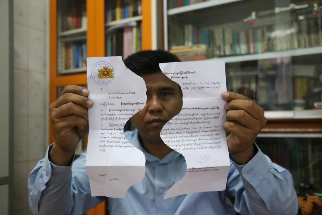 Ko Nay Myo Linn, chief editor of Mandalay-based Voice of Myanmar, holds up his rejected application to register to cover the President's Office. The torn application was returned to him after he was released in early April. (Kaung Zaw Hein | Supplied)