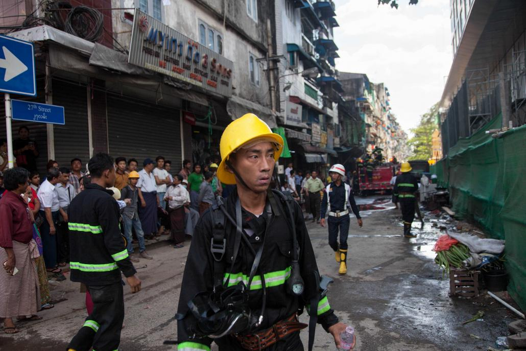 "/></p><p>Among the dead firefighters were two from the headquarters, two from the Kyauktada Township fire station and one from Tarmwe.</p><p>The injured included Kyi Win, who in 2013 became head of the Yangon Region Fire Services Department.</p><p>""It's our job to fight fires but I hope we never have another incident like that warehouse explosion,"" he told <em>Frontier</em> recently.</p><h2 class="