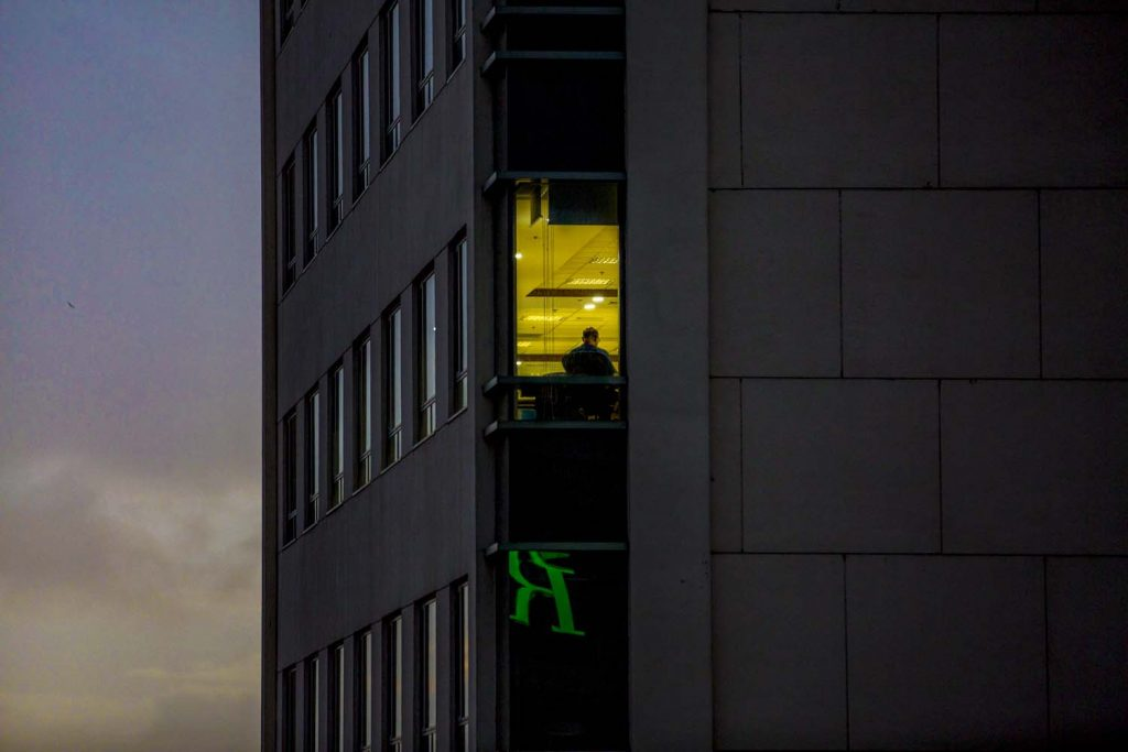 An office worker inside Sule Square in downtown Yangon on the evening of July 10. (Hkun Lat | Frontier)