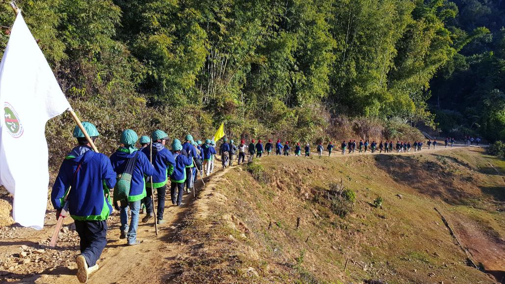 Pat Jasan volunteers march along the Chipwi road in rural Waingmaw Township during a mission to destroy poppy fields in 2016. (Supplied)