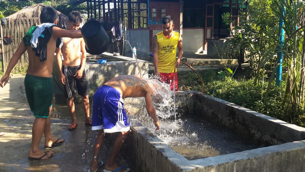 A drug user is given a cold bath to relieve his withdrawal symptoms at the Ram Hkye Shalat rehabilitation centre on Myitkyina's outskirts. (Supplied)