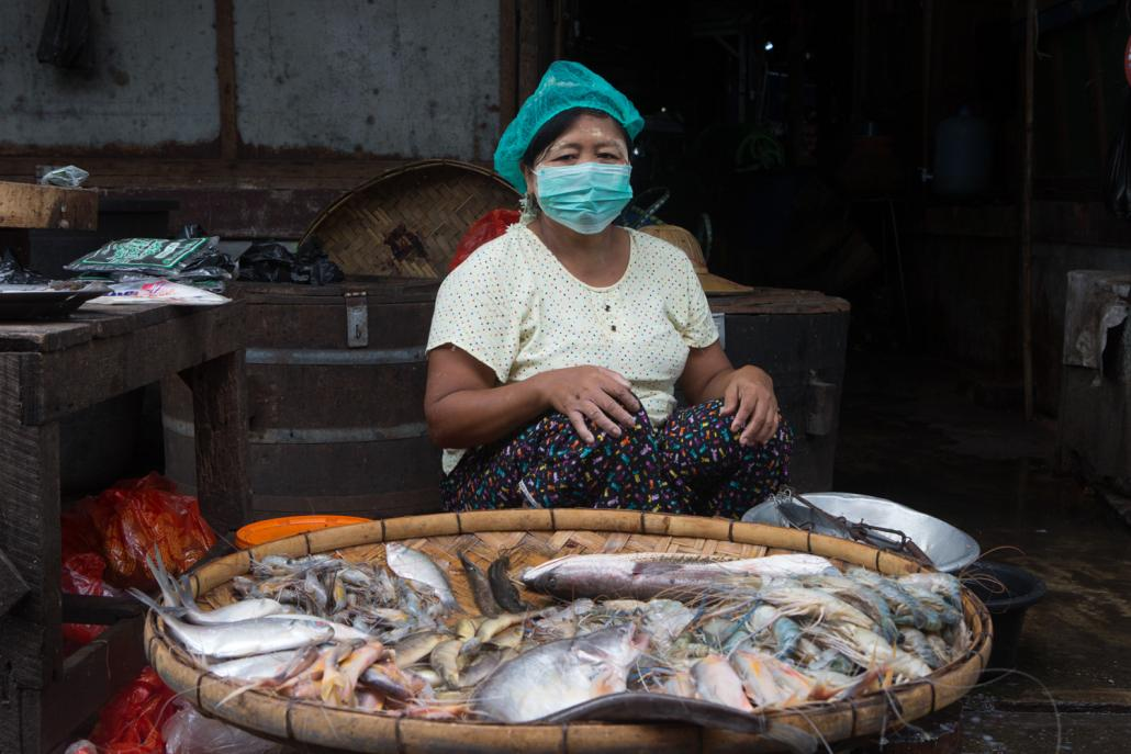 Fish vendor Daw Hla Hla waits for customers at Insein Market. (Thuya Zaw | Frontier)