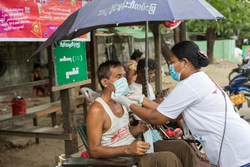"""We Love Insein"" volunteers distribute facemasks to the public in Insein Township on May 17. (Thuya Zaw 