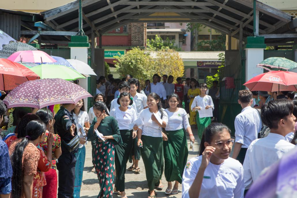 Students leave a school in Yangon's Mingalar Taung Nyunt Township after sitting a matriculation exam in March. (Thuya Zaw | Frontier)