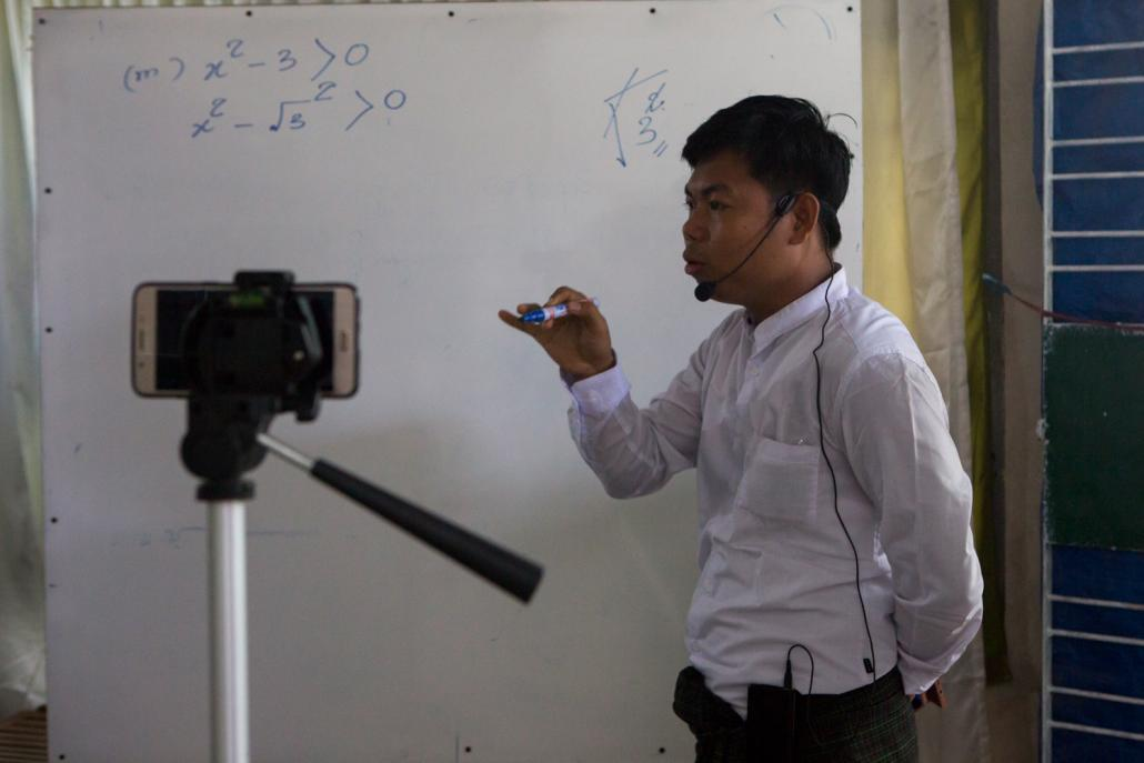 A teacher at Grindstone private school in Yangon's Htantabin Township conducts a class over Zoom, a videoconferencing software that has enabled classes to continue remotely using the internet. (Thuya Zaw | Frontier)