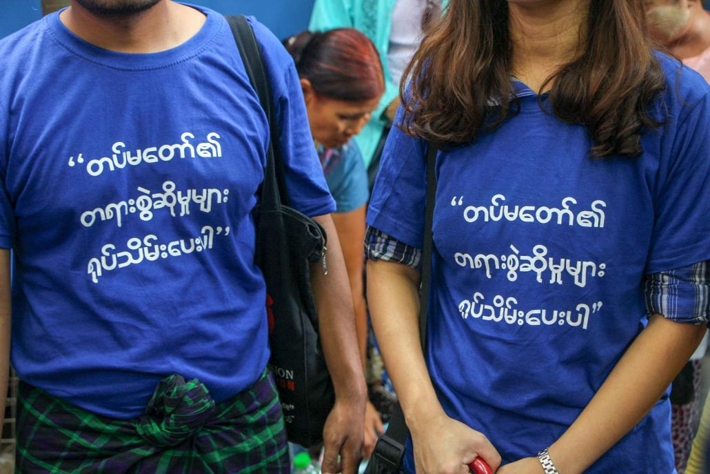 Youth activists attending U Min Htin Ko Ko Gyi's trial on May 23 wear t-shirts demanding that numerous