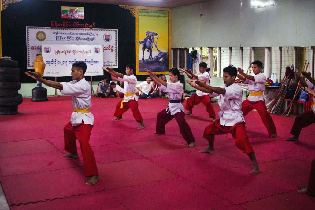 Thaing students train with a sword. Veteran thaing practitioners want it to be taught in schools across the country as part of the national curriculum. (Thuya Zaw | Frontier)