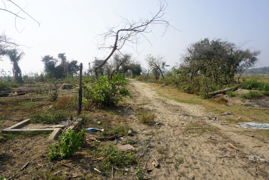 Charred debris of houses and vegetation are seen in the abandoned Rohingya village of Inn Din, in Rakhine State's Maungdaw Township. (Joe Freeman   AFP)
