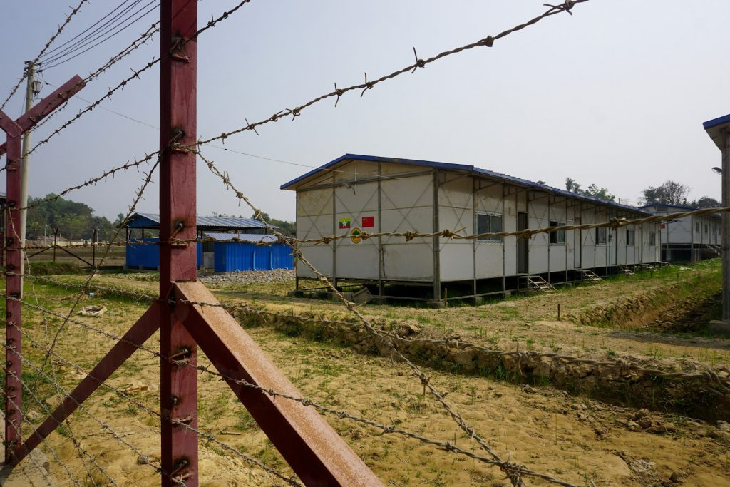 A processing camp for Rohingya Muslims pasted with Myanmar and Chinese flag stickers is seen in Maungdaw in Rakhine State in March 2018. (Joe Freeman | AFP)