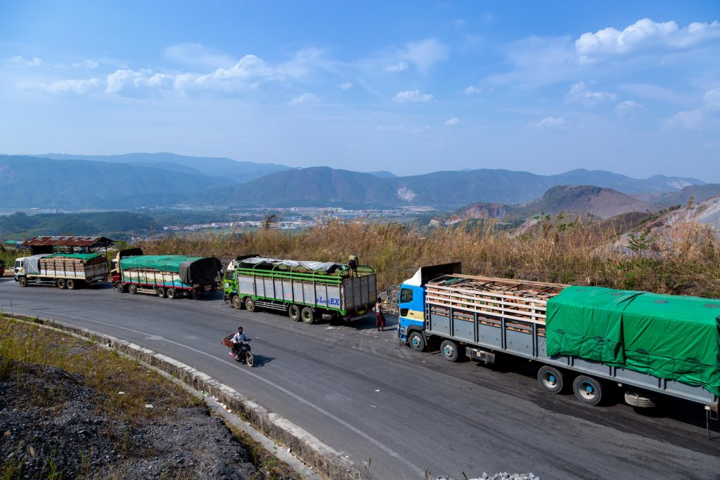 Trucks wait near Muse in Shan State to enter China on April 20 after Chinese authorities introduced restrictions to combat the spread of COVID-19. (AFP)