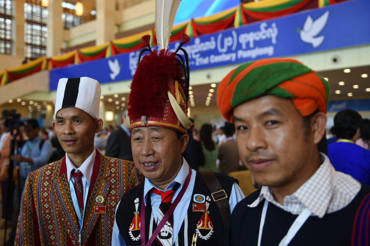 Chin, Naga and Pa-O representatives, wearing traditional costumes, pose for a picture during the opening of a peace conference in Nay Pyi Taw on August 31, 2016. (AFP)