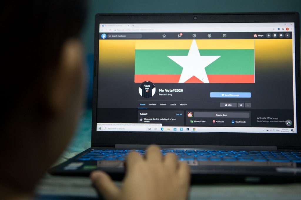 "A Facebook user browses one of several groups and pages belonging to the ""no vote"" community. (Thuya Zaw 