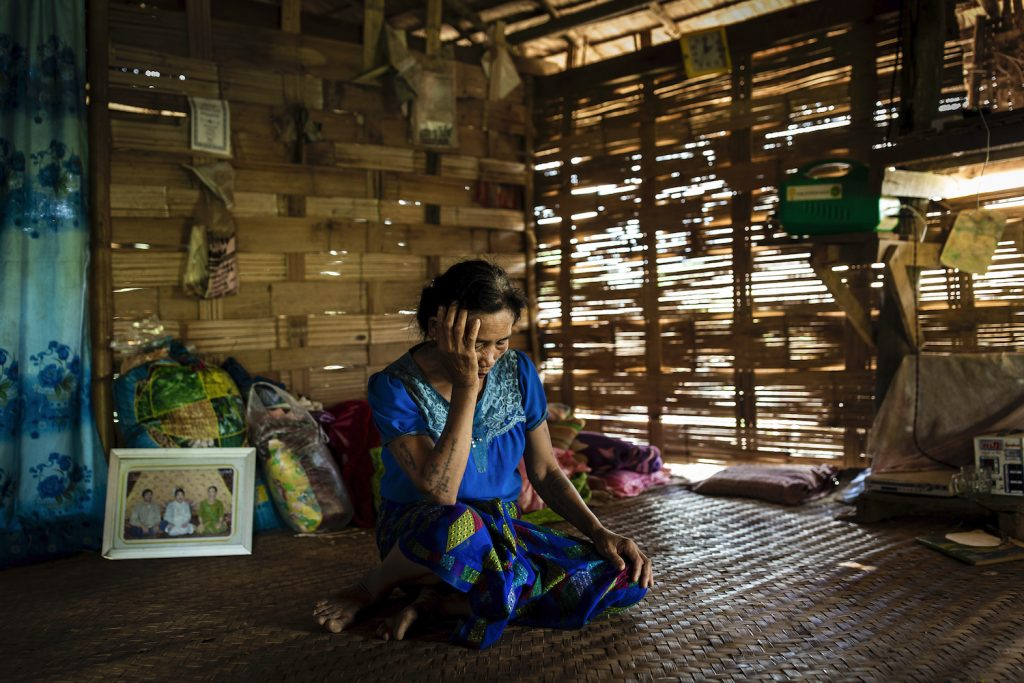Nang Shwe, 56, inside her home in Pang Kyin village on August 4. Her husband was shot and killed by Tatmadaw soldiers on June 29 after taking shelter in the village school. (Hkun Lat |Frontier)