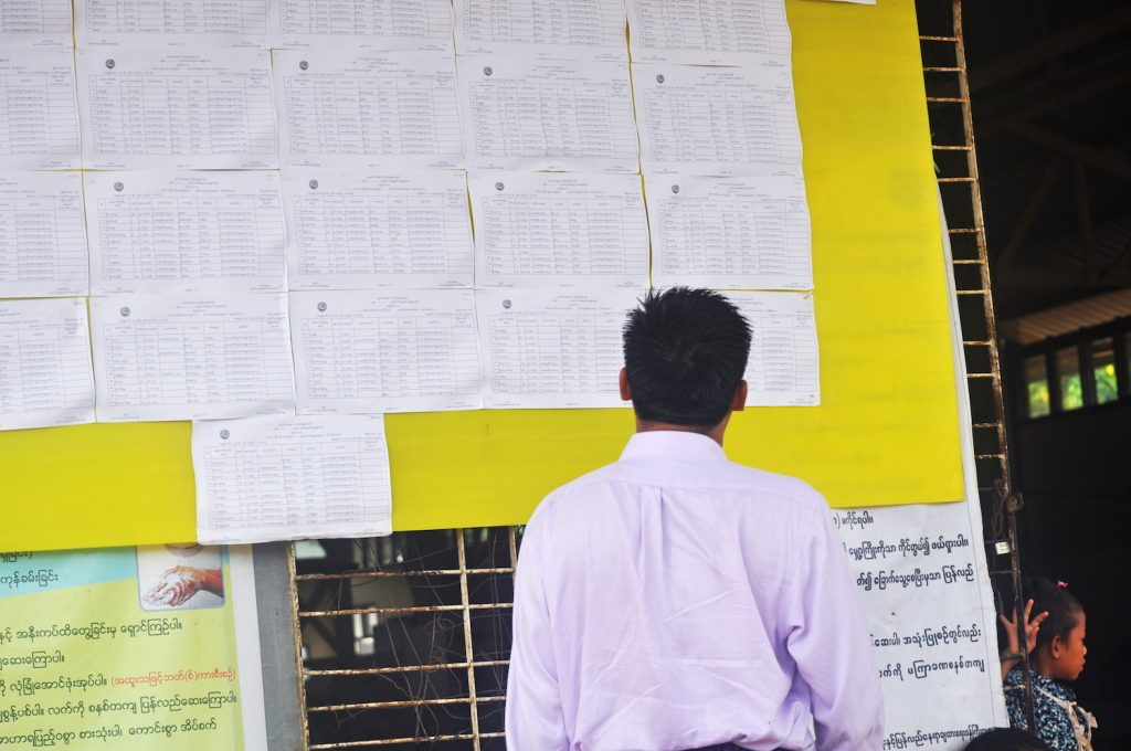 A man checks voter lists displayed in Zay Ward in Rakhine State's Ann Township. (Kaung Hset Naing | Frontier)