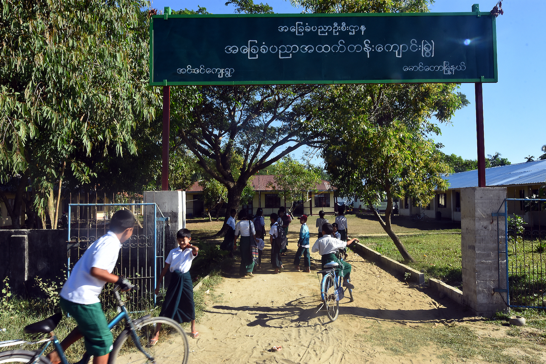 Children arrive at a school in Inn Din village, Maungdaw Township, in November 2018. (Steve Tickner | Frontier)