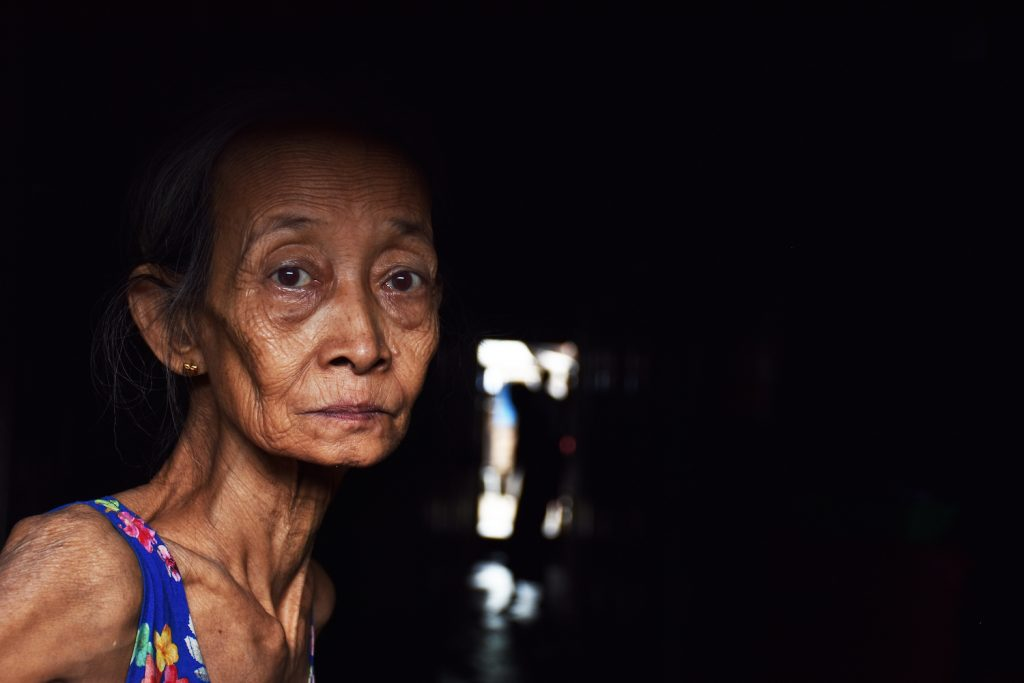 An elderly resident of Hlaing Tharyar township's Yay Okkan Ward. (Steve Tickner | Frontier)