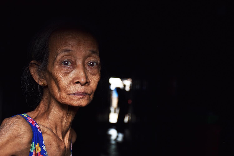 An elderly resident of Hlaing Tharyar township's Yay Okkan Ward. (Steve Tickner | Frontier)