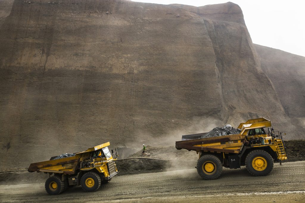 Dump trucks carry waste from a company mining site in Hpakant Township on May 21, 2019. (Hkun Lat | Frontier)