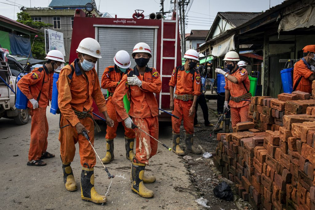Firefighters prepare to disinfect a market in Mrauk-U as COVID-19 cases surge in the north of the state. (Hkun Lat I Frontier)