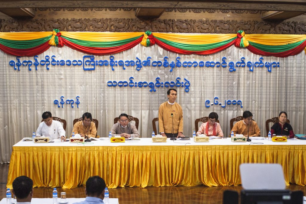 Members of the Yangon Region cabinet, including Karen ethnic affairs minister Naw Pan Thinzar Myo (far right) and Rakhine ethnic affairs minister U Zaw Aye Maung (far left), at a press conference in June 2017. (Theint Mon Soe | Frontier)