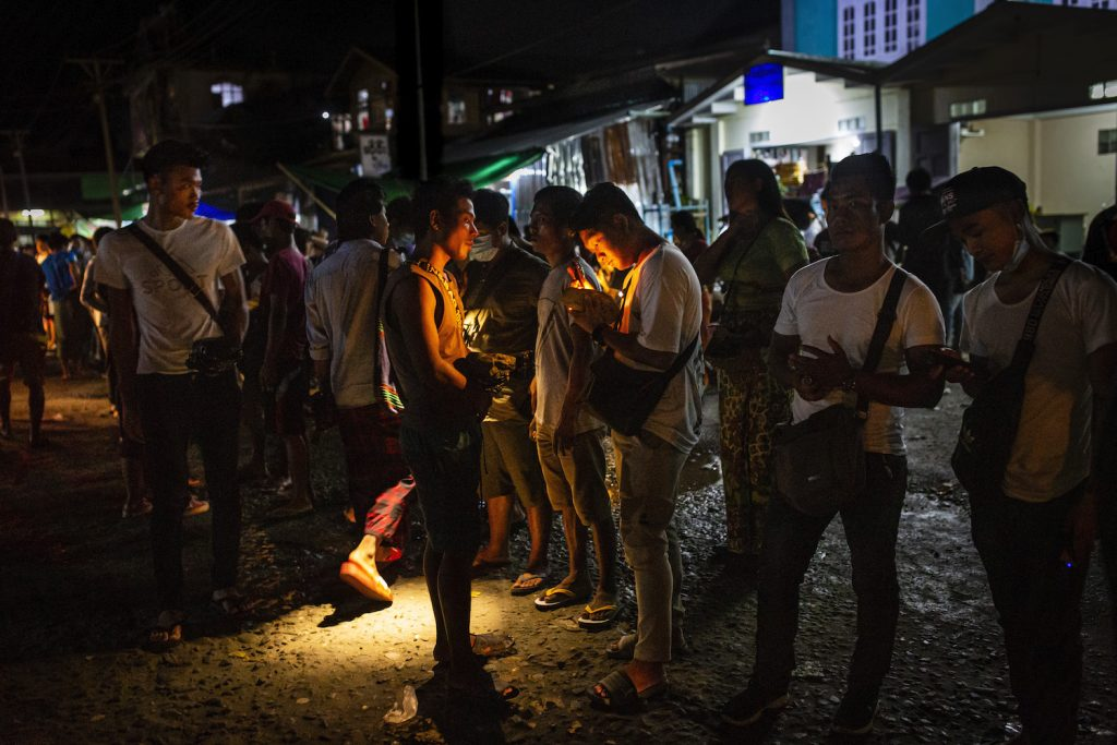 Jade buyers use flashlights to determine the value of stones at Hpakant Township's Lunghkang jade market on July 15, 2020. (Hkun Lat | Frontier)