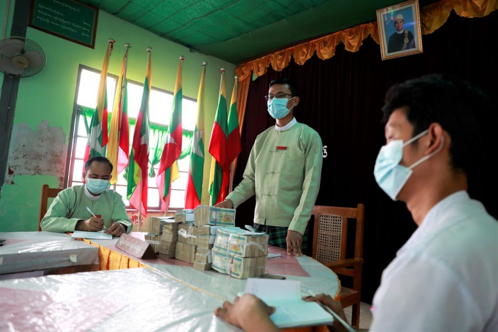 The Dawbon Township General Administration Department prepares to hand over cash to ward administrators on July 24 for distribution to needy families. (Nyein Su Wai Kyaw Soe | Frontier)