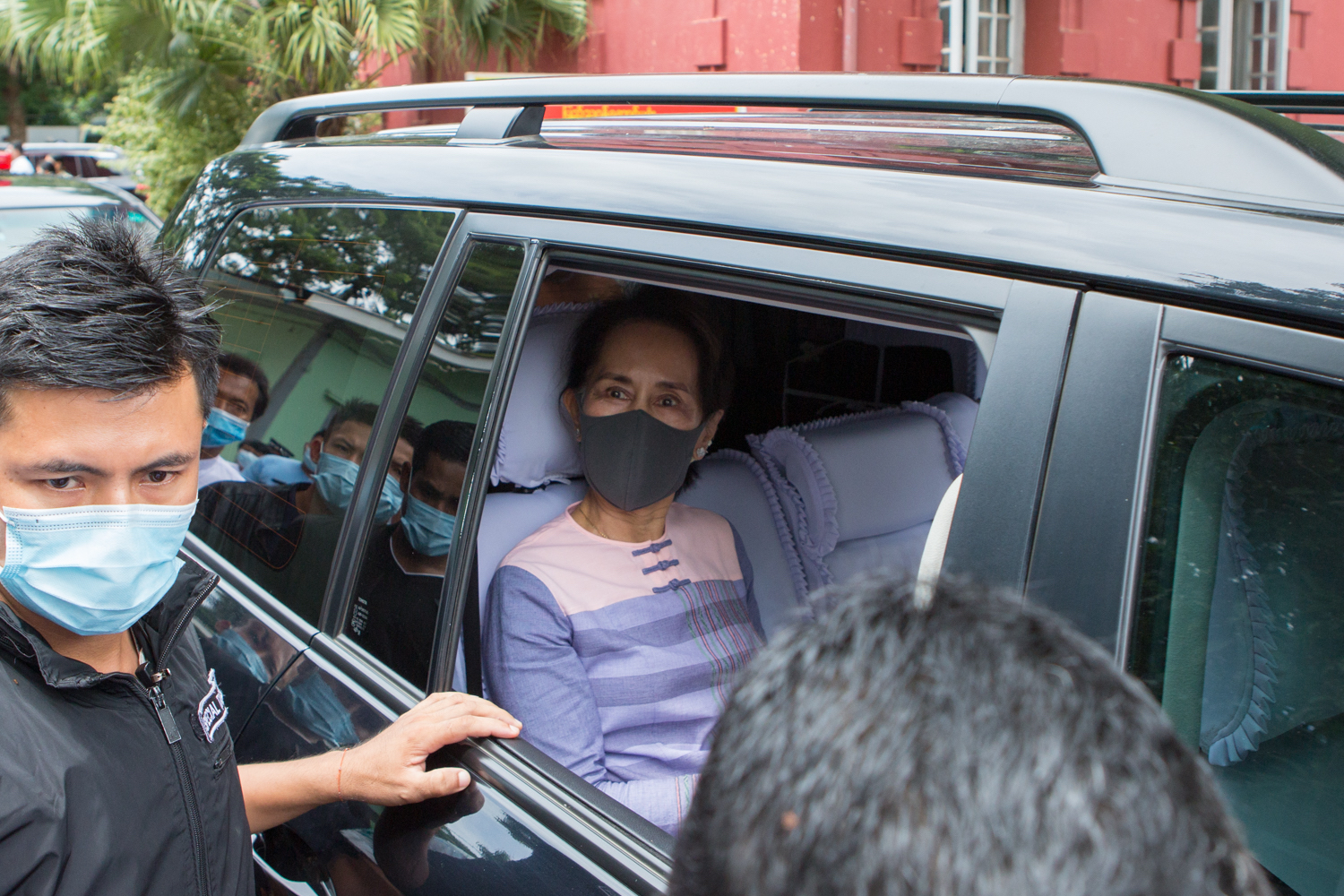 State Counsellor Daw Aung San Suu Kyi leaves the election sub- commission office for Yangon's Southern District on August 4 after registering as a candidate for Kawhmu Township's lower house race. (Thuya Zaw | Frontier)