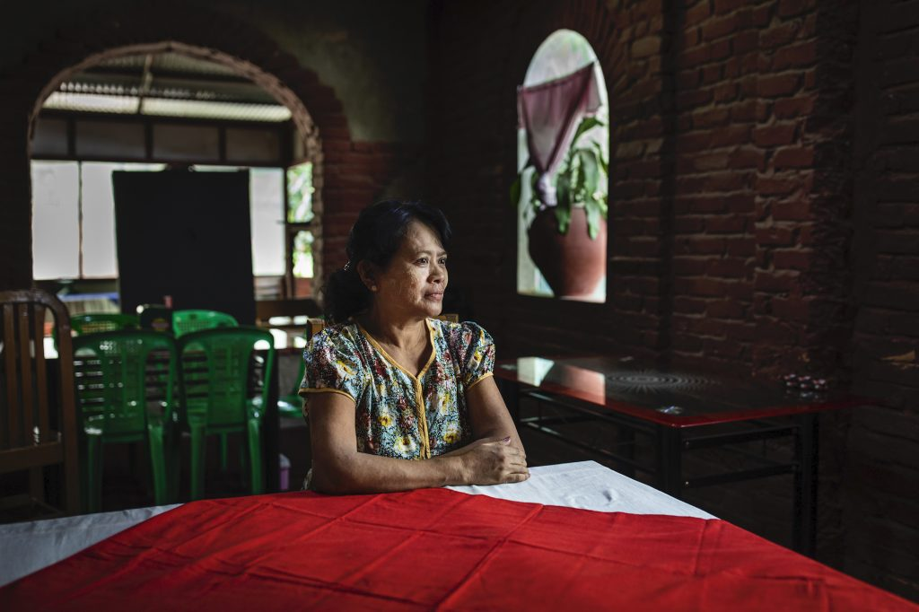 Daw Mi Shwe Phyu, 55, at her Moe Cherry restaurant in downtown Mrauk-U on August 21. (Hkun Lat | Frontier)