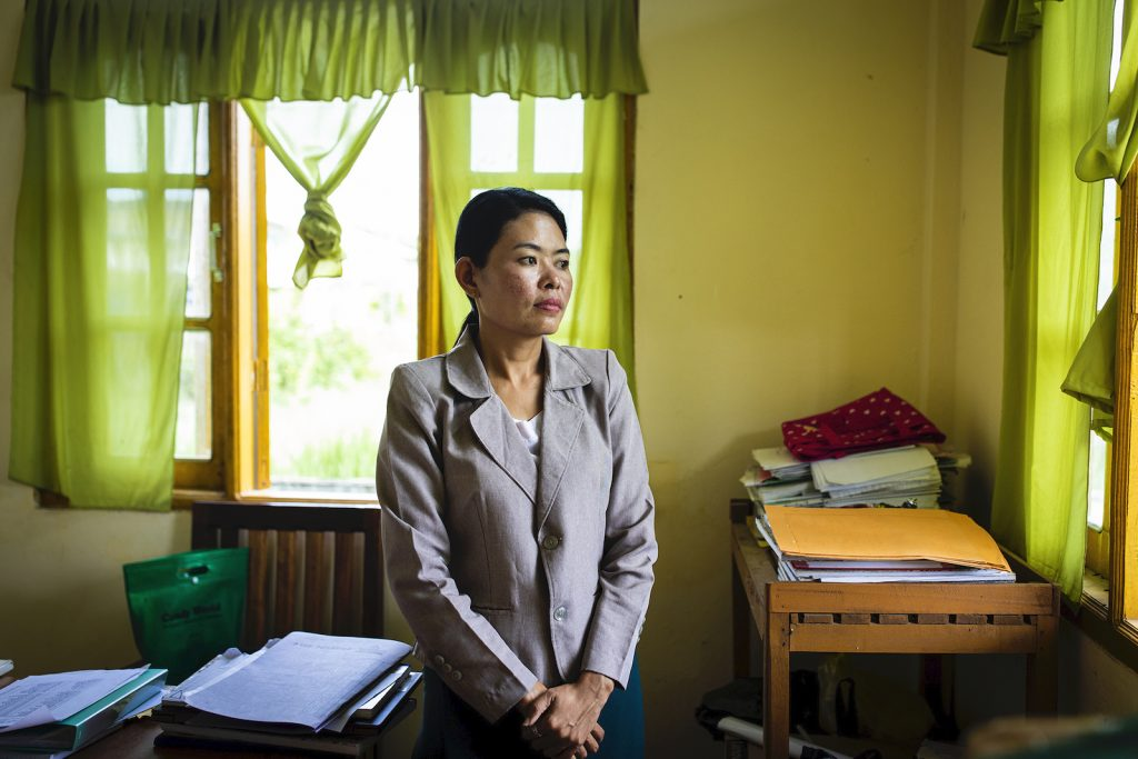 Daw Thida Khaing, 36, secretary of the Mrauk-U Township election sub-commission, at her office in Mrauk-U on August 21. (Hkun Lat | Frontier)