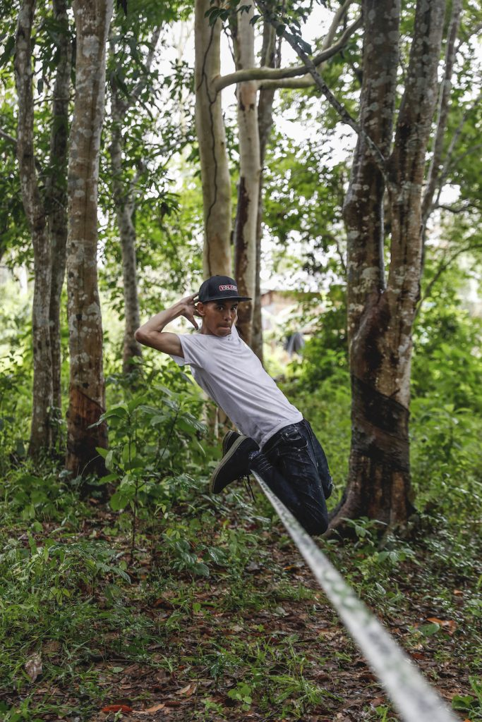 "Ko Ye Win Tun performs acrobatic tricks on his slackline – what practitioners call ""tricklining."" (Nyein Su Wai Kyaw Soe 