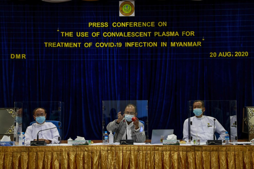President of the Ad-hoc Advisory Committee for Convalescent Plasma Treatment Dr Rai Mra, middle, speaks on a panel at a conference in Yangon on August 29. (Nyein Su Wai Kyaw Soe | Frontier)