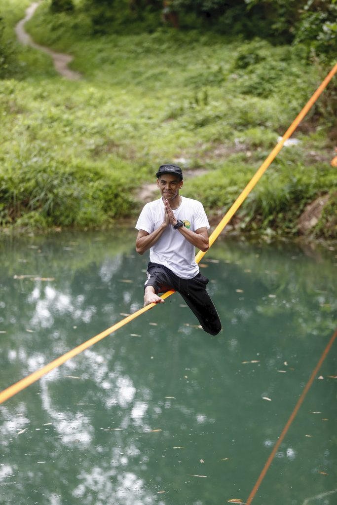 "Ko Ye Win Tun balances on a slackline above a pond – what practitioners call ""waterlining."" (Nyein Su Wai Kyaw Soe 