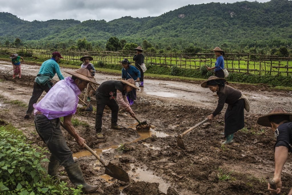 Ta'ang IDPs work on a village road construction project in Kutkai Township to earn some income. (Hkun Lat | Frontier)