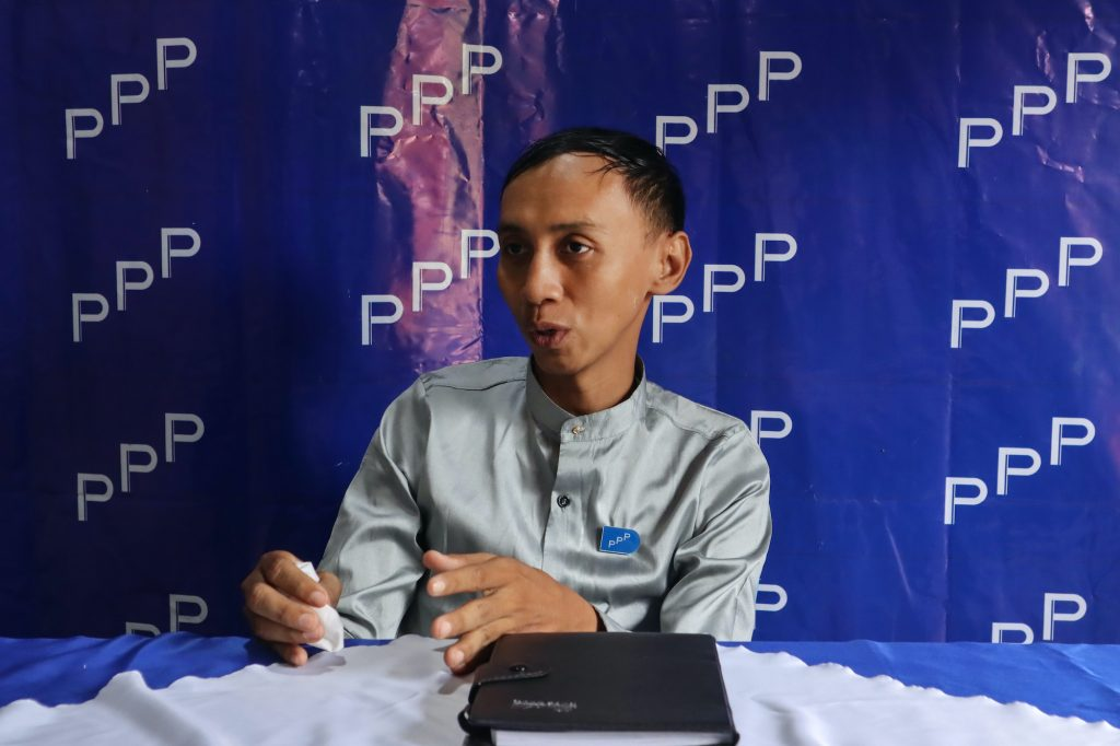 People's Pioneer Party candidate Myo Min Tun speaks to the media on September 12 at his Mandalay office. (AFP)