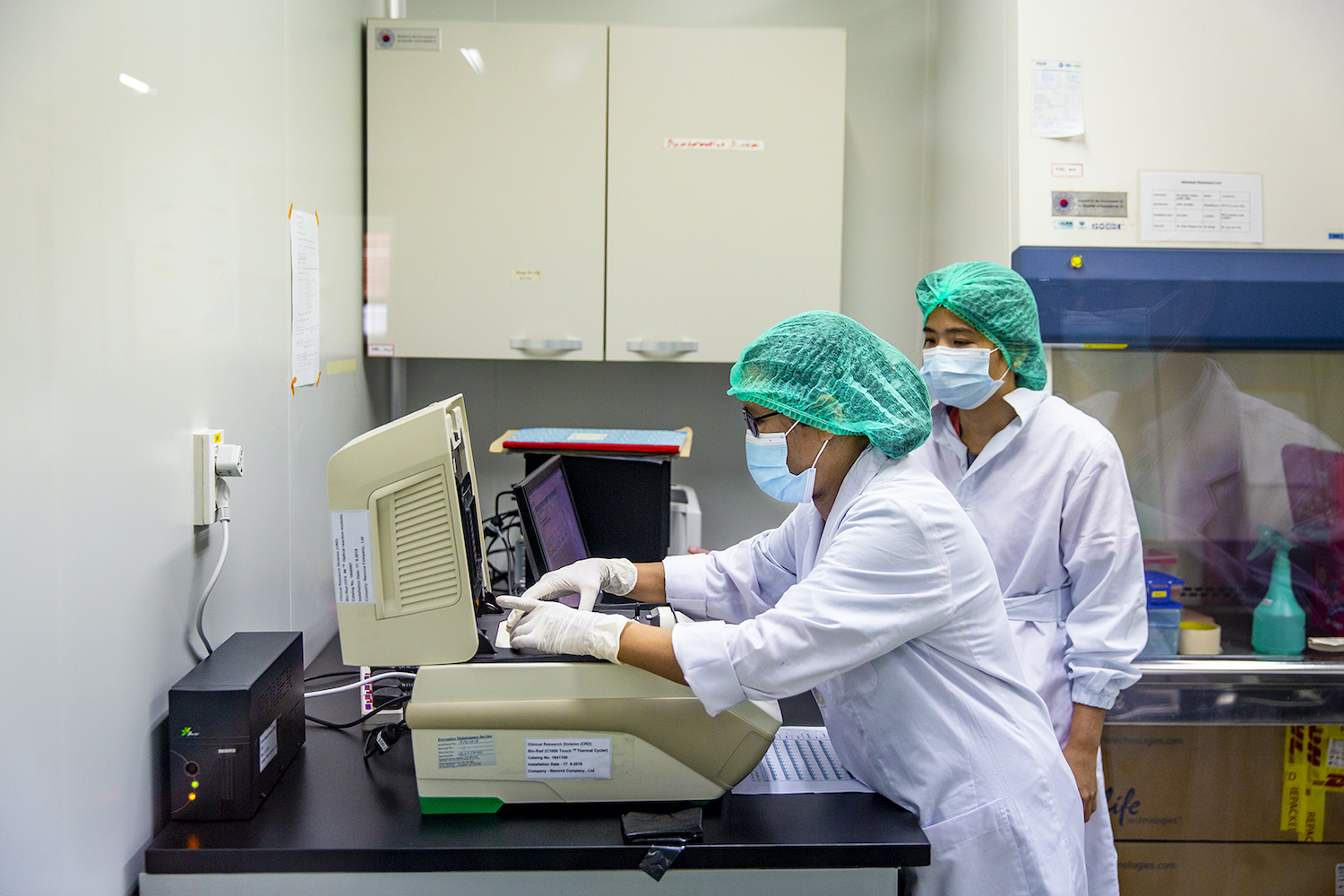 Lab technicians test COVID-19 samples at the Department of Medical Research's laboratory in Yangon on May 21, 2020. The country's COVID-19 response, including testing, has ground to a halt in the wakr of the February 1 coup. (Frontier)