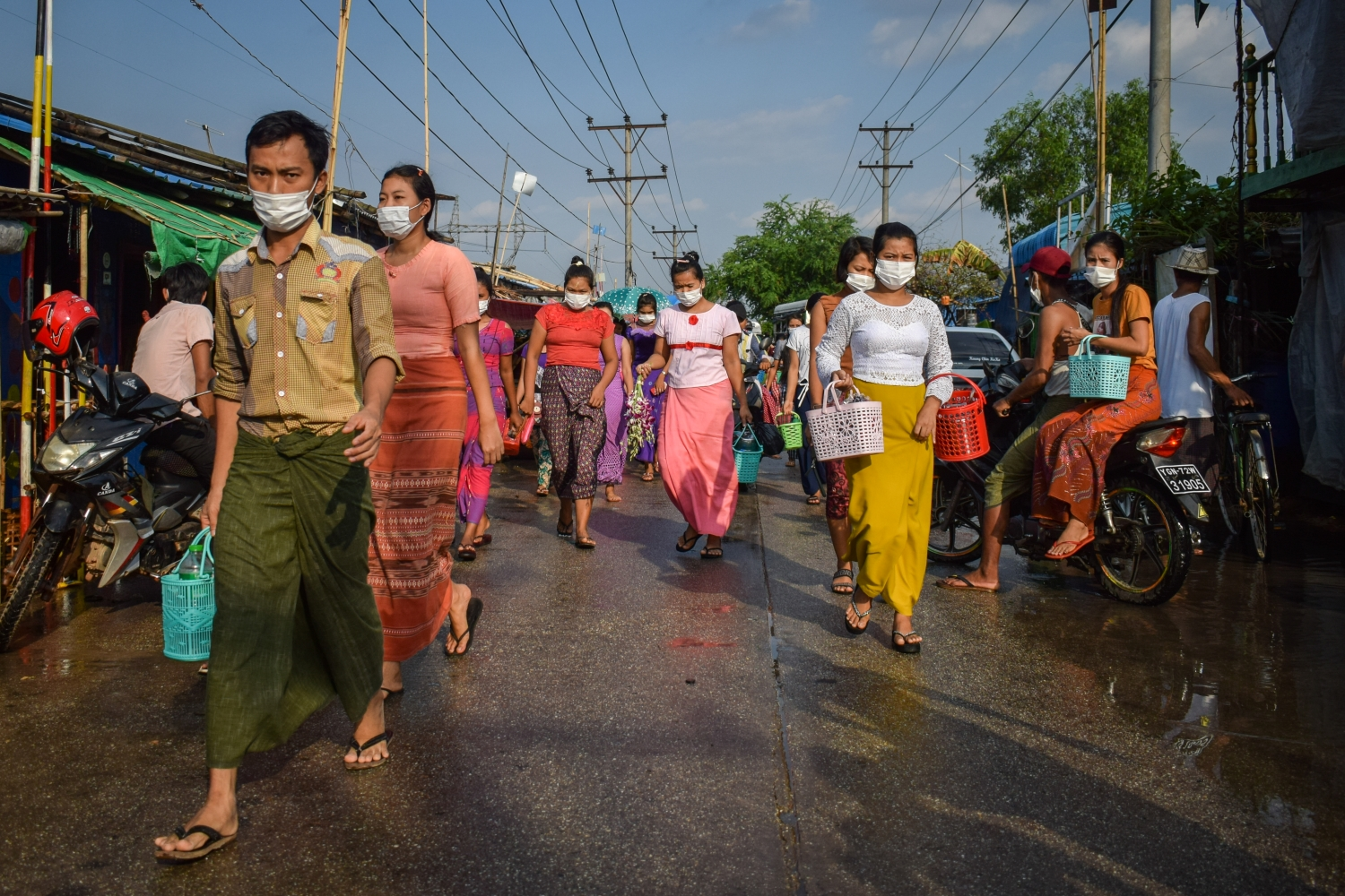 Yangon factory workers walk to work on May 16. The industrial workforce of the city largely consists of migrants from poor rural areas, many of whom are vulnerable to disenfranchisement because they are registered to vote elsewhere. (Kyaw Lin Htoon | Frontier)